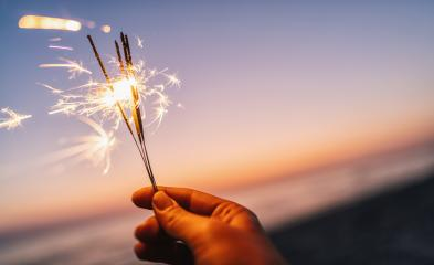 hand holding sparkler at sunset light- Stock Photo or Stock Video of rcfotostock | RC-Photo-Stock