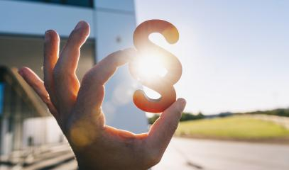 Hand holds paragraph in the sun as a sign of justice - Stock Photo or Stock Video of rcfotostock | RC-Photo-Stock