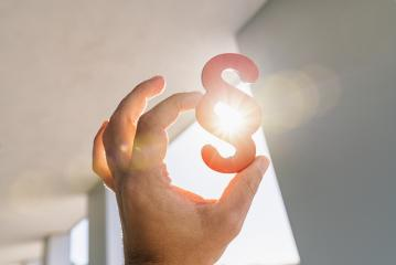 Hand holds paragraph symbol in the sun  at a office building- Stock Photo or Stock Video of rcfotostock | RC-Photo-Stock