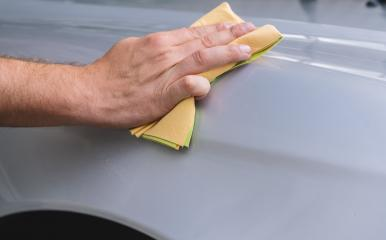 hand holds the microfiber in hand and polishes the car- Stock Photo or Stock Video of rcfotostock | RC-Photo-Stock