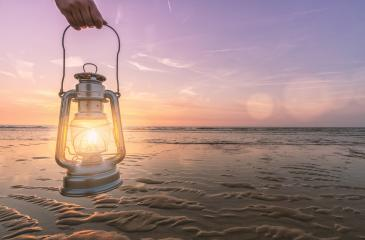 hand holds vintage lantern at the beach at sunset. copyspace for your individual text.- Stock Photo or Stock Video of rcfotostock | RC-Photo-Stock