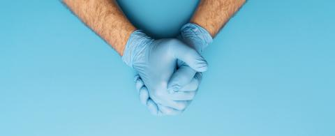 Hand in medical gloves.  Medical banner on blue background. Care concept image- Stock Photo or Stock Video of rcfotostock | RC-Photo-Stock