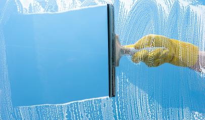 Hand in yellow rubber glove cleaning window on a blue sky - Stock Photo or Stock Video of rcfotostock | RC-Photo-Stock
