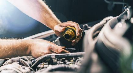 Hand mechanic in repairing car,Change the Oil- Stock Photo or Stock Video of rcfotostock | RC-Photo-Stock