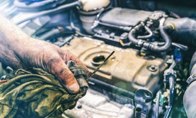 Hand of car mechanic check engine oil for maintenance- Stock Photo or Stock Video of rcfotostock   RC-Photo-Stock