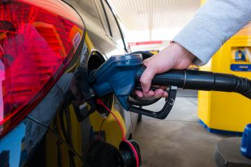Hand refilling the car with fuel at the refuel station- Stock Photo or Stock Video of rcfotostock | RC-Photo-Stock