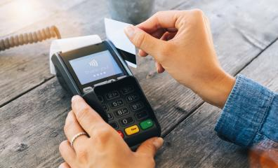Hand swipe red credit through payment terminal - Stock Photo or Stock Video of rcfotostock | RC-Photo-Stock