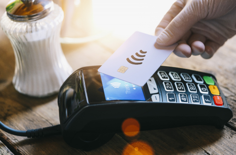 hand with medical latex protective gloves pays with wireless or contactless payment card on payment terminal in a cafe. Protection for Coronavirus COVID-19. - Stock Photo or Stock Video of rcfotostock | RC-Photo-Stock