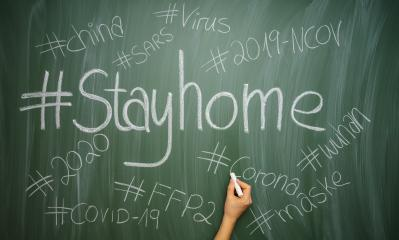 hand writes stay home hastags or Slogans for anti virus protection to prevent corona COVID-19 infection on a green chalkboard : Stock Photo or Stock Video Download rcfotostock photos, images and assets rcfotostock | RC-Photo-Stock.: