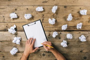 Hands holding clipboard and write Mock-up or ideas with crumpled paper balls. Brainstorming Concept image- Stock Photo or Stock Video of rcfotostock | RC-Photo-Stock