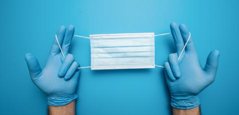 Hands in gloves showing medical face mask on blue background. Preventive measures to protect against Covid-19 Corona virus infection.- Stock Photo or Stock Video of rcfotostock | RC-Photo-Stock