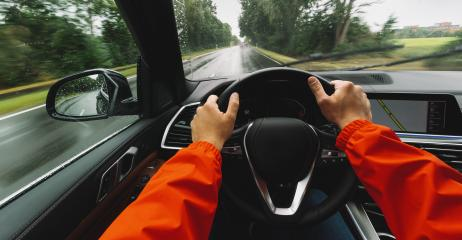 hands of car driver on steering wheel, Driving car at a rainy day on a country road,  road trip - POV, first person view shot- Stock Photo or Stock Video of rcfotostock | RC-Photo-Stock