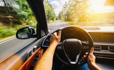 hands of car driver on steering wheel, Driving car at summer day on a country road, having fun driving the empty highway on tour journey - POV, first person view shot- Stock Photo or Stock Video of rcfotostock | RC-Photo-Stock