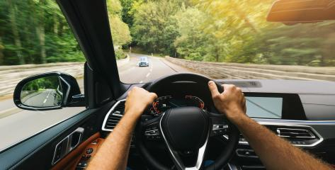 Hands of car driver on steering wheel, fast driving car at spring day on a country road, having fun driving the empty highway on tour journey - POV first person view shot- Stock Photo or Stock Video of rcfotostock | RC-Photo-Stock