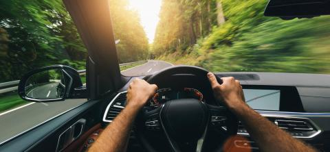 Hands of car driver on steering wheel, fast driving car at spring day on a country road, having fun driving the empty highway on tour journey - POV first person view shot : Stock Photo or Stock Video Download rcfotostock photos, images and assets rcfotostock | RC-Photo-Stock.: