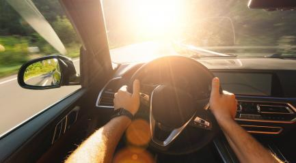 hands of car driver on steering wheel, road trip, driving on forest road with bright sunlight- Stock Photo or Stock Video of rcfotostock | RC-Photo-Stock