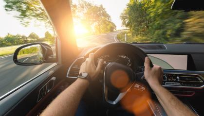 hands of car driver on steering wheel, road trip, driving on forest road- Stock Photo or Stock Video of rcfotostock | RC-Photo-Stock