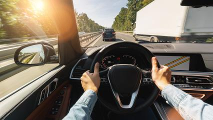 hands of car driver on steering wheel, road trip, driving on highway road- Stock Photo or Stock Video of rcfotostock   RC-Photo-Stock
