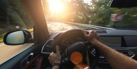 hands of car driver on stheering wheel, road trip, driving on forest road- Stock Photo or Stock Video of rcfotostock | RC-Photo-Stock