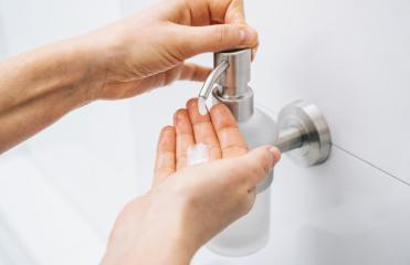 hands using wash hand sanitizer gel pump dispenser. Clear sanitizer in pump bottle, for killing germs, bacteria and virus. : Stock Photo or Stock Video Download rcfotostock photos, images and assets rcfotostock | RC-Photo-Stock.: