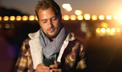 Handsome young man sms texting using app on smart phone at autum /summer sunset in city- Stock Photo or Stock Video of rcfotostock | RC-Photo-Stock