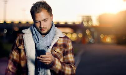 Handsome young man sms texting using app on smart phone at autum /summer sunset in city : Stock Photo or Stock Video Download rcfotostock photos, images and assets rcfotostock | RC-Photo-Stock.: