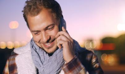 Handsome young man speaking on smart phone at autumn sunset in city- Stock Photo or Stock Video of rcfotostock   RC-Photo-Stock