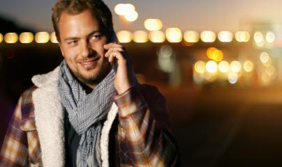 Handsome young man speaking on smart phone at autumn sunset in city- Stock Photo or Stock Video of rcfotostock | RC-Photo-Stock