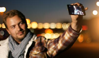 Handsome young man speaking on smart phone at autumn sunset in city : Stock Photo or Stock Video Download rcfotostock photos, images and assets rcfotostock | RC-Photo-Stock.: