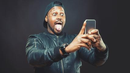Handsome young man use his smart phone for a selfie shot  : Stock Photo or Stock Video Download rcfotostock photos, images and assets rcfotostock | RC-Photo-Stock.: