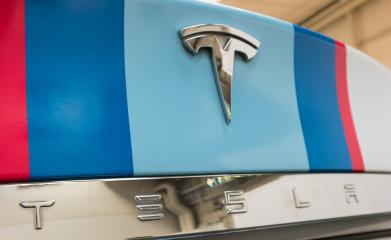 HANNOVER, GERMANY MARCH, 2017: Close-up of a Tesla Logo on a car. Tesla Motors, Inc. is an American automotive and energy storage company.- Stock Photo or Stock Video of rcfotostock | RC-Photo-Stock