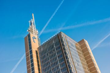 HANNOVER, GERMANY MARCH, 2017: Hannover Messe Tower building with the logo of Deutsche Messe AG on top. Home of Cebit, the largest IT fair in the world.- Stock Photo or Stock Video of rcfotostock | RC-Photo-Stock