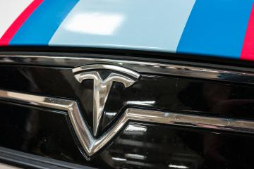 HANNOVER, GERMANY MARCH, 2017: Tesla Logo on a car grill. Tesla Motors, Inc. is an American automotive and energy storage company.- Stock Photo or Stock Video of rcfotostock | RC-Photo-Stock