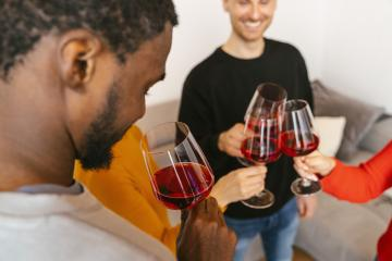 Happy friends having fun and drinking wine - Friendship concept with young people enjoying harvest time together at farmhouse vineyard countryside - Warm filter with focus on faces in center of frame- Stock Photo or Stock Video of rcfotostock | RC-Photo-Stock