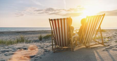 Happy Romantic Couple Enjoying Beautiful Sunset at the Beach and toasting with wine- Stock Photo or Stock Video of rcfotostock | RC-Photo-Stock