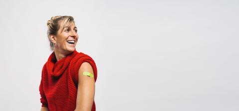 Happy Vaccinated Woman Showing Arm With Green Plaster Bandage After Covid-19 Vaccine Injection, looking away, Coronavirus Vaccination Advertisement Concept Image, Copy Space Banner Gray Background : Stock Photo or Stock Video Download rcfotostock photos, images and assets rcfotostock | RC-Photo-Stock.:
