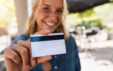 Happy young woman shows  credit card in a cafe- Stock Photo or Stock Video of rcfotostock | RC-Photo-Stock