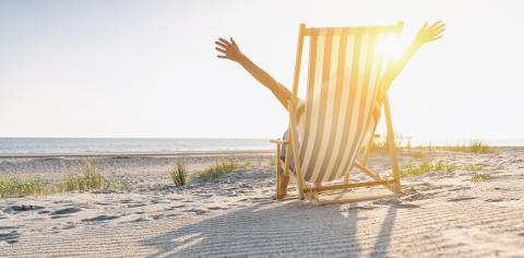 happy young woman sitting on beach chair on beach at summer, copyspace for your individual text, banner size- Stock Photo or Stock Video of rcfotostock | RC-Photo-Stock