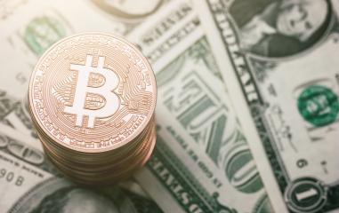 heap of Bitcoin (BTC) cryptocurrency on dollar notes, digital money concept image : Stock Photo or Stock Video Download rcfotostock photos, images and assets rcfotostock | RC-Photo-Stock.: