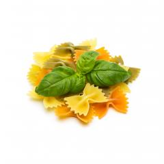heap of colorful Farfalle noodles with basil- Stock Photo or Stock Video of rcfotostock | RC-Photo-Stock