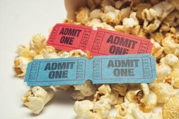 heap of popcorn with tickets for cinema- Stock Photo or Stock Video of rcfotostock | RC-Photo-Stock