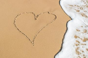 Heart drawn on the beach sand with sea foam and wave : Stock Photo or Stock Video Download rcfotostock photos, images and assets rcfotostock | RC-Photo-Stock.: