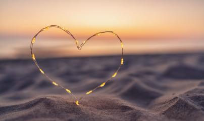 Heart shape made of led lights at the beach sand- Stock Photo or Stock Video of rcfotostock | RC-Photo-Stock