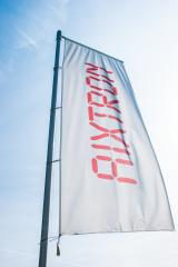 HERZOGENRATH, GERMANY MARCH, 2017: Aixtron flag against blue sky. The engineering company.produces equipment for the production of compound semiconductors and other multicomponent materials.- Stock Photo or Stock Video of rcfotostock | RC-Photo-Stock