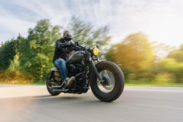 High power motorcycle chopper on the country road riding at summer. having fun driving the empty road on a motorcycle tour- Stock Photo or Stock Video of rcfotostock   RC-Photo-Stock
