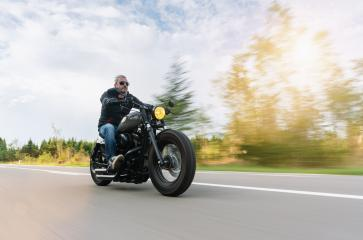 High power motorcycle chopper on the country road riding. having fun driving the empty road on a motorcycle tour- Stock Photo or Stock Video of rcfotostock | RC-Photo-Stock