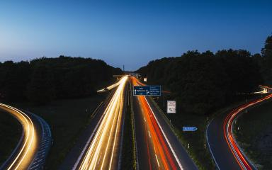 highway crossing with lighttrails at night- Stock Photo or Stock Video of rcfotostock   RC-Photo-Stock