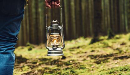 hiker holding a Old oil lamp in the forest. copyspace for your individual text. - Stock Photo or Stock Video of rcfotostock | RC-Photo-Stock
