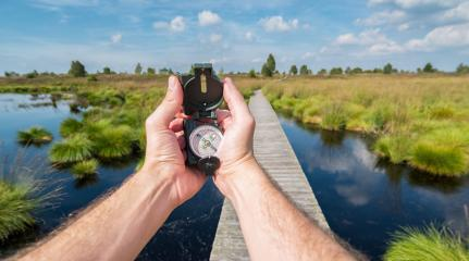 Hiker man searching direction with a compass in the hautes fagnes. Point of view shot- Stock Photo or Stock Video of rcfotostock | RC-Photo-Stock