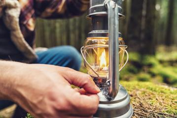 Hiker using a Gasoline lantern in the forest- Stock Photo or Stock Video of rcfotostock | RC-Photo-Stock